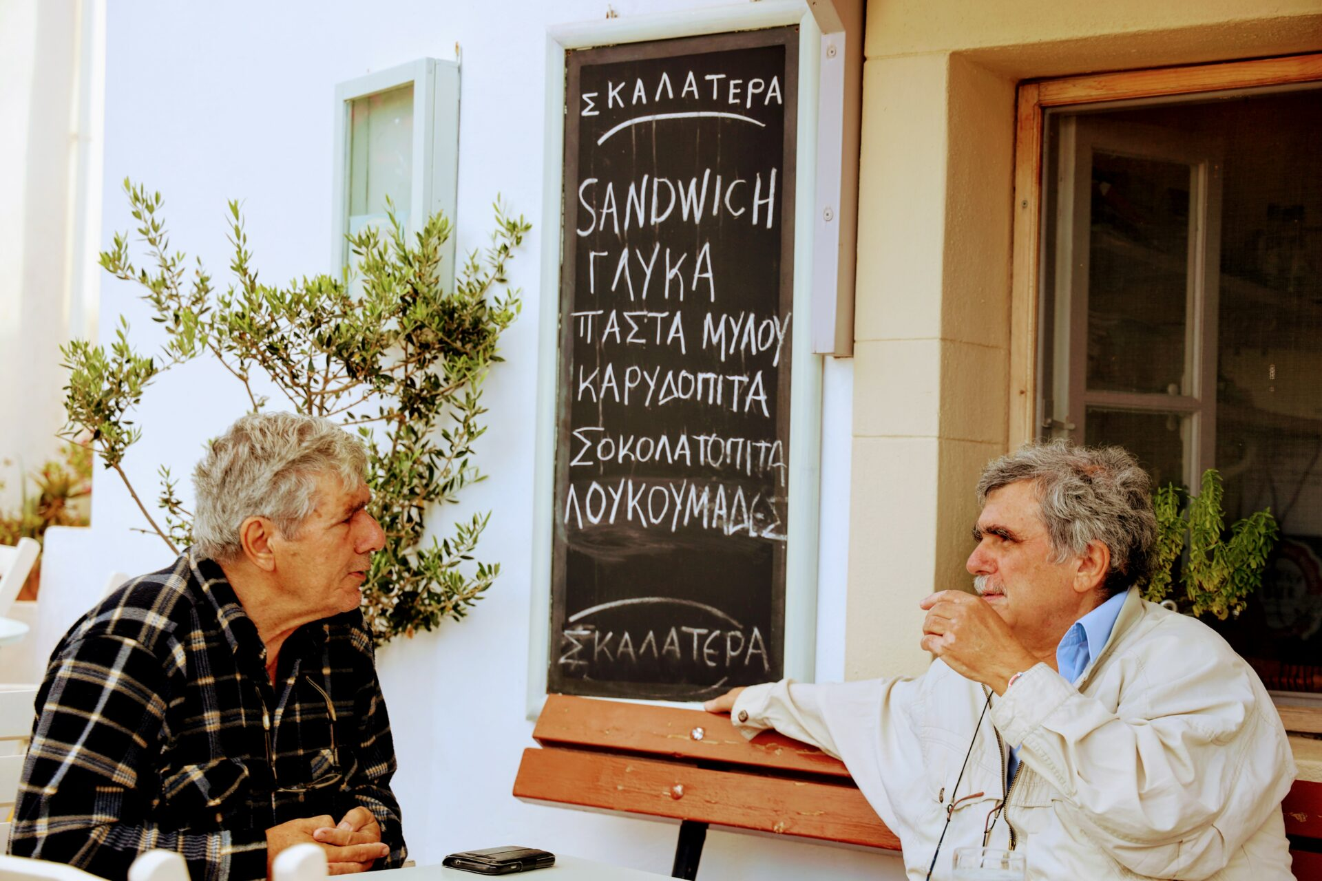 Locals chatting in Greece, Kthera island, 2 old greek men on a Saturday morning having a coffee
