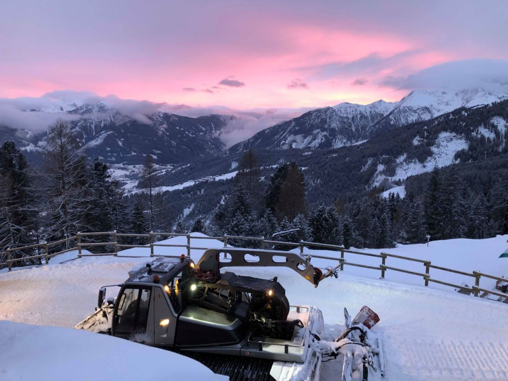 Sunset in Val Di Fassa - view over mountains and snowcat