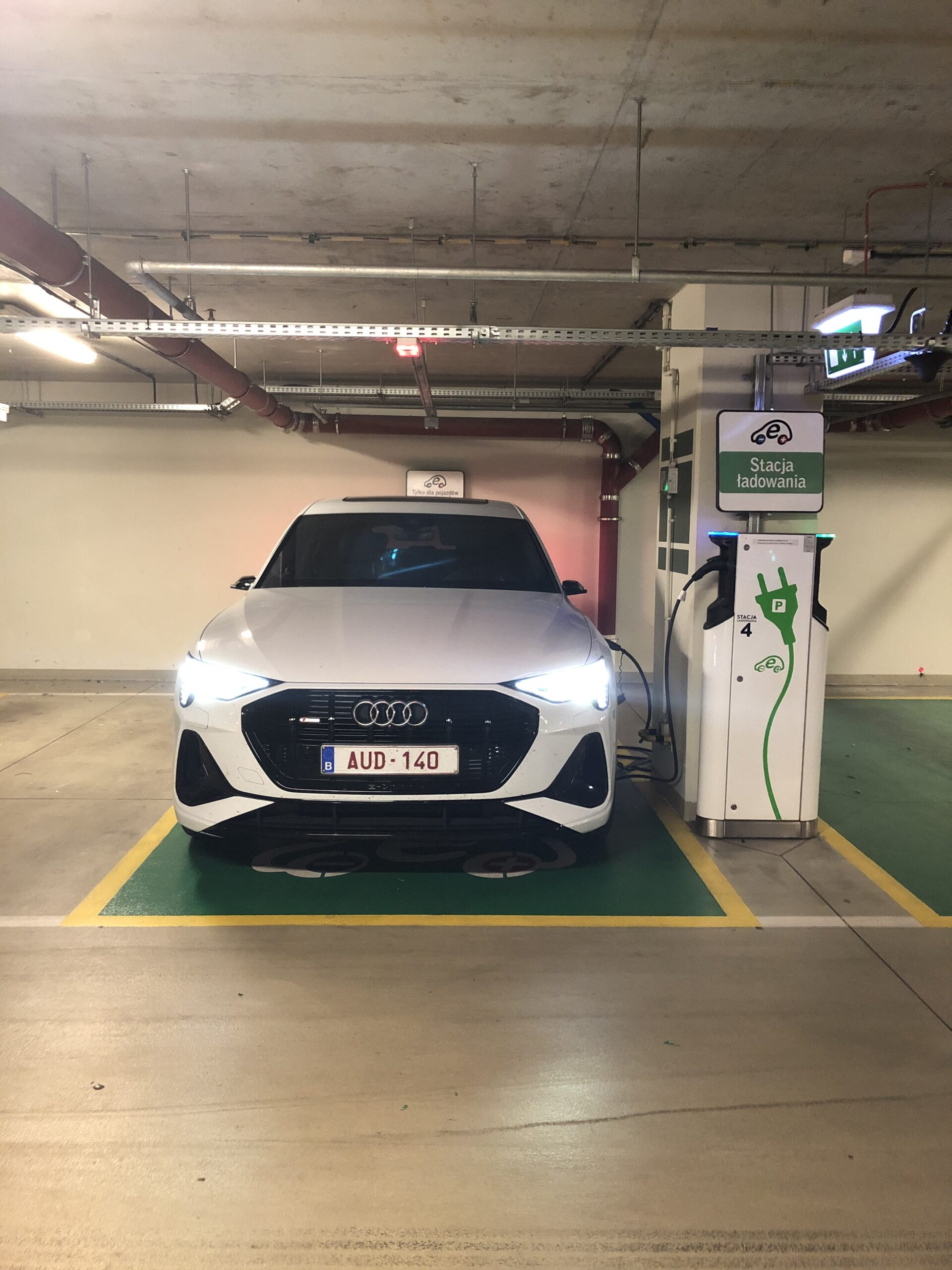 Audi e-tron Sportback charging in a public parking